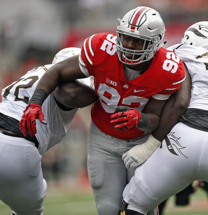 Ohio State Buckeyes defensive lineman Adolphus Washington (92) gets past Western Michigan Broncos offensive lineman Taylor Moton (72) and Western Michigan Broncos offensive lineman Chukwuma Okorafor (77) in the 1st quarter of their game at Ohio Stadium on September 26, 2015. (Dispatch photo by Kyle Robertson)