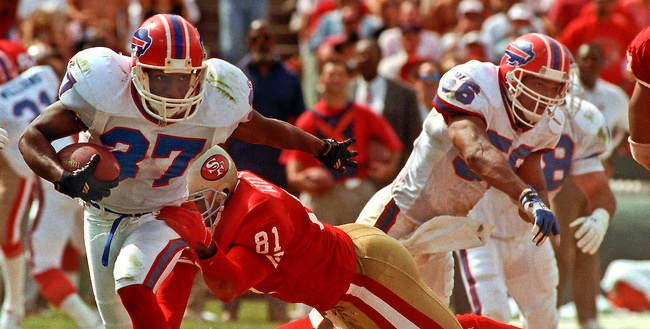San Francisco 49ers vs. Buffalo Bills at Candlestick Park Sunday, September 12, 1992. Bills beat 49ers 34-31. San Francisco 49ers tight end Jamie Williams (81) attempts to tackle Buffalo Bills defensive back Nate Odomes (37) after interception.